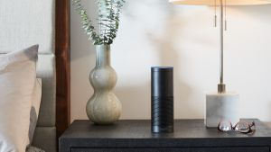 The cylindrical speaker is the biggest of the Echo family, with a speaker grille and a Smart home hub built in