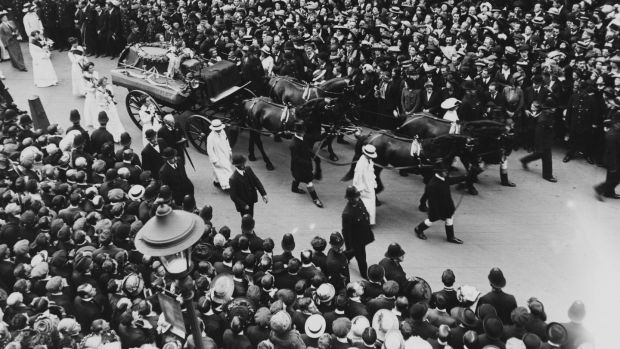 Crowds line the street as the funeral procession of English suffragette Emily Davison (1872 - 1913) passes through a London street, June 14th, 1913. Davison died after she ran in front of Anmer, a horse owned by the King, at the Epsom Derby on 4th June. Photograph: Hulton Archive/Getty Images