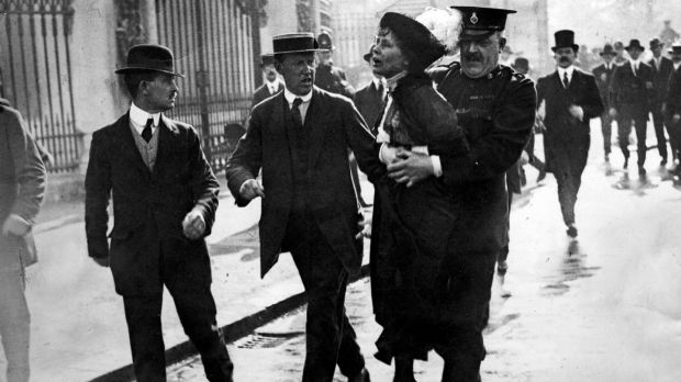 English suffragette Emmeline Pankhurst (1858 - 1928), is arrested at a demonstration outside Buckingham Palace, London. Photograph: by Jimmy Sime/Getty Images