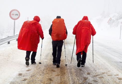 DETERMINATION: Three pilgrims make their way to Saint James through snow and cold temperatures in Lugo, Galicia, northwestern Spain. Almost all the regions of Spain are on alert due to snowy weather.  Eliseo Trigo/EPA