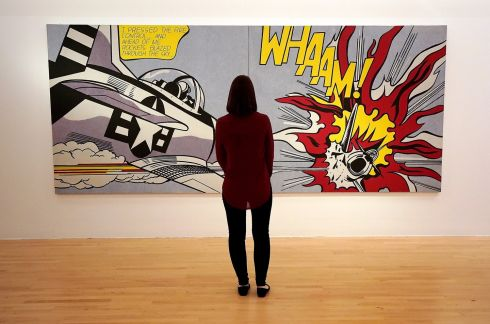 RESTORED LICHTENSTEIN A gallery assistant views a restored artwork, Whaam!, by Roy Lichtenstein, on display at the Tate Liverpool gallery in England. Photograph: Christopher Furlong/Getty Images