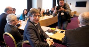 Ousted Catalan leader Carles Puigdemont attends a meeting in Brussels on Monday with representatives of pro-independence parties. Photograph: Virginia Mayo/AP