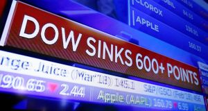 A TV screen displays the Dow Jones industrial average on the floor of the New York Stock Exchange last Friday. Photograph: Richard Drew/AP