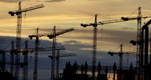 Past cranes over Dublin: There are fears in Government  that the prioritisation of cities under the National Development Plan will be seen as neglect of rural Ireland. File photograph: Dara Mac Dónaill/The Irish Times