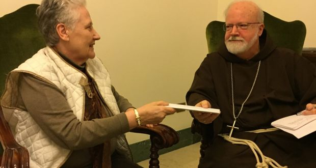 Marie Collins handing the letter detailing victims' complaints of a sex abuse cover up in Chile to Cardinal Seán O'Malley on April 12th 2015.