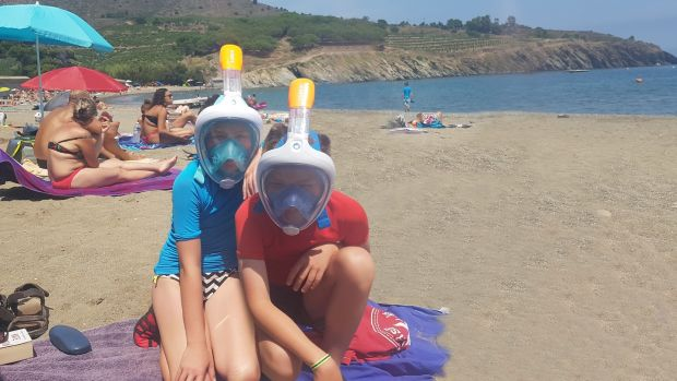 Holly and Milo Garry sporting their Decathlon snorkels, swimwear and microfibre towel in France