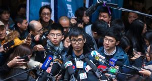 Pro-democracy activists Joshua Wong (left), Alex Chow (centre) and Nathan Law talk to journalists outside Hong Kong's court of final appeal on Tuesday. Photograph:  Alex Hofford/EPA