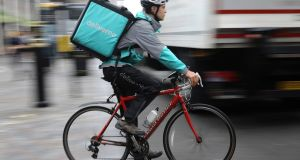 "Discussions about the so-called ""gig economy"" are usually in the context of large firms such as Deliveroo, Uber and Airbnb. Photograph: Dan Kitwood/Getty Images"