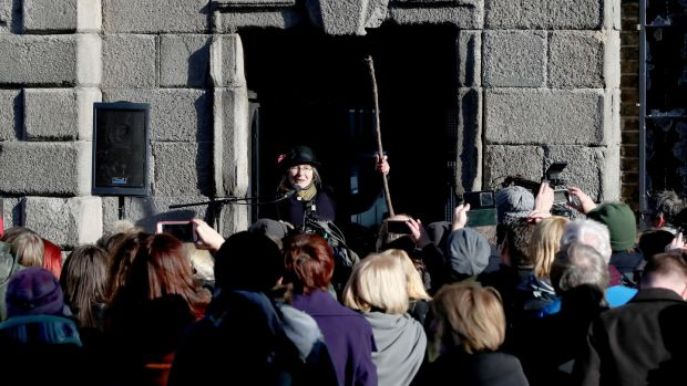 To mark the centenary of women getting the vote in Ireland, Micheline Sheehy the granddaughter of suffragette Hanna Sheehy Skeffington addresses crowds after she re-enacted her grandmother smashing the windows of Dublin Castle to highlight women's disenfranchisement. Photograph: Niall Carson/PA Wire