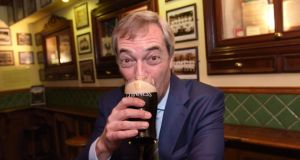 Nigel Farage: grinning prop for a pint? Photograph: Bryan Meade