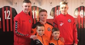 Bohemians players Steven Nolan, Jamie Hamilton and Darragh Leahy with St Kevin's Boys Michael and Zach.