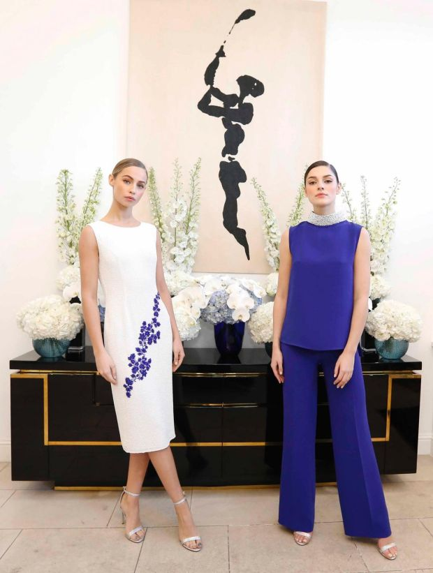 Thalia (L) wearing Rada Dress (POA) and Kelly wearing Simona Embellished Sapphire Crepe Top (€795), Rachel Crepe Sapphire Trousers (€495). Photograph: Sasko Lazarov/Photocall Ireland
