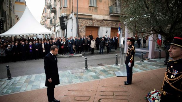French president Emmanuel Macron pays his respects during the unveiling of a plaque in Ajaccio, Corsica, in tribute to slain French prefect Claude Érignac, who was assassinated 20 years ago in a nationalist attack that shocked the country and brought tens of thousands of Corsicans onto the streets in protest. Photograph:Kamil Zihnioglu/AFP/Getty Images