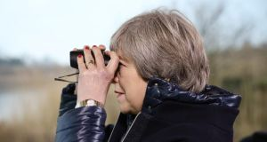 "Theresa May: Michel Barnier has warned the PM that ""without a customs union and outside the single market, barriers to trade in goods and services are unavoidable"". Photograph: Dan Kitwood/Getty"