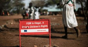A warning sign against female genital mutilation in Uganda. The UN estimates more than 200 million girls and women have experienced FGM.  Photograph: Yasuyoshi Chiba/AFP/Getty Images