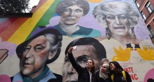 Students take a selfie against a mural including Emmeline Pankhurst (top left) in Manchester to mark the 100th anniversary of the Representation of People Act which allowed women to vote in the UK. Photograph: Anthony Devlin/Getty Images