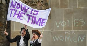 Lea Taylor and Nicola Wright dressed in Suffragettes costume hold a mock protest on the Royal Mile on February 6th, 2018 in Edinburgh, Scotland. Photograph:  Jeff J Mitchell/Getty Images