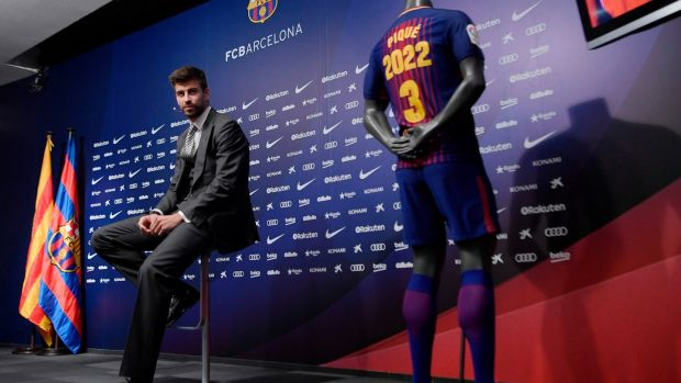 Barcelona's Catalan defender Gerard Pique attends a press conference to officially announce his contract renewal at the Camp Nou stadium. Photograph: Getty Images