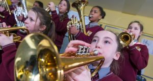 Schoolkids learning musical instruments with tutor Michael Mullins at Scoil na Croise Naofa, Avenue de Rennes, Mahon, Cork city. Photograph: Michael Mac Sweeney/Provision