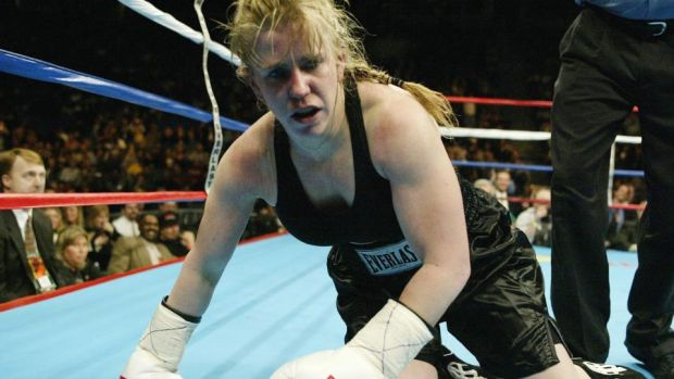 Tonya Harding falls to the floor during a fight with Samantha Browning in a second round during their women's bantamweight bout in 2003. Photograph: Al Bello/Getty Images