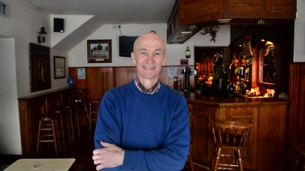 "Terry Coughlan of Coughlan's Bar, Moate: ""A lot of the businesses here are struggling, especially with people ordering online."" Photograph: Dara Mac Dónaill"
