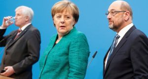Christian Democratic Union leader and German chancellor Angela Merkel, Christian Social Union leader Horst Seehofer (left) and Social Democratic Party leader Martin Schulz speaking in Berlin on Wednesday. Photograph: Hannibal Hanschke/Reuters