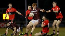 NUIG's Peter Cooke is tackled by Cathal Bambury of UCC during the Sigerson Cup quarter-final at the Mardyke. Photograph: Oisín Keniry/Inpho
