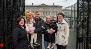 Elena and Costel Focsa with their daughter Cezy Focsa (11)  and Padraig McIntyre and Barbara Frow with their daughter Grace McIntyre (10) outside the Dail. Photograph: Brenda Fitzsimons