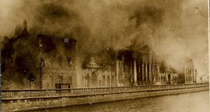 The Four Courts in Dublin burning during a Civil War battle on June 30th, 1922. The Public Records Office, and with it a huge swathe of Irish cultural memory, was destroyed. File photograph: National Library of Ireland