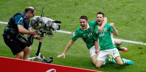 One for the cameras... Celebrating the goal against Sweden with Robbie Brady. Photograph: Charles Platiau