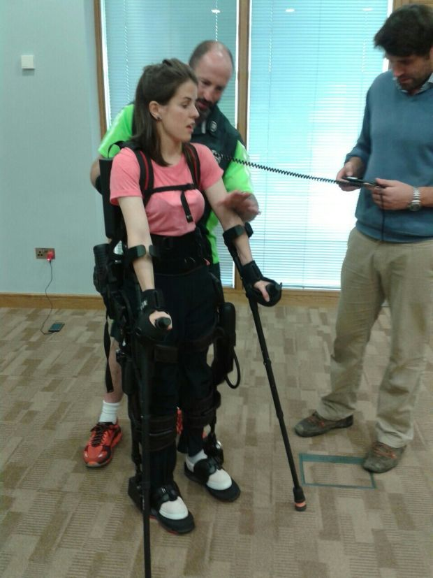 Geraldine Lavelle using a bionic suit which enables people with paralysis or lower limb weakness to passively walk