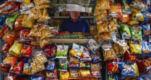 Kiosks in Santiago's city center feature products with black nutritional warnings on the labels of items high in sugar, salt, calories or saturated fat. Photograph: Victor Ruiz Caballero for The New York Times