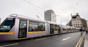 Luas number 5027, a 55-metre tram, photographed on O'Connell Bridge on Thursday morning. Photograph: Brenda Fitzsimons.