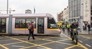Luas number 5027 a 55-metre tram photographed on O'Connell Bridge on Thursday morning. Photograph: Brenda Fitzsimons.