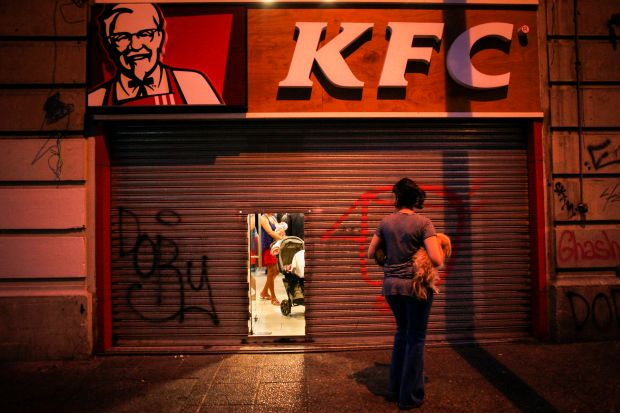 A KFC restaurant in Chile. In 2016, the medical costs of obesity were 2.4 percent of all health care spending.