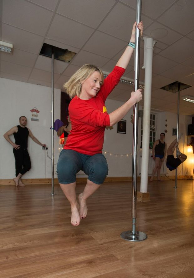 Fiona had been dying to swing around the pole since she set foot in the studio and was not left disappointed. Photograph: Dave Meehan/The Irish Times