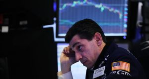 Wall Street headache: A trader at work on the floor of the New York Stock Exchange on Monday, when the Dow Jones fell more than 1,500 points in intraday trading. Photograph: Spencer Platt/Getty Images
