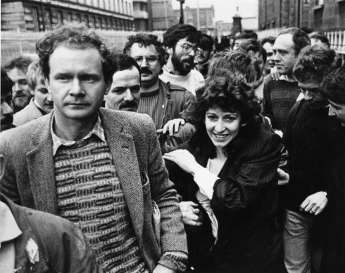 Ms Evelyn Glenholmes, after being released for the second time by the District Court in Dublin in 1986 with supporters including Mr Martin McGuinness (front left), Mr Gerry Adams (rear centre) and Mr Danny Morrison (rear right), of Sinn Fein.  Photograph: Pat Langan / The Irish Times