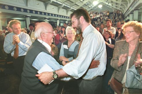 The veteran Republican Mr Joe Cahill is congratulated by the Sinn Fein president Mr Gerry Adams after his appointment as honorary party vice president at the Sinn Fein ard fheis in the RDS in 1999.  Photograph: Matt Kavanagh / The Irish Times
