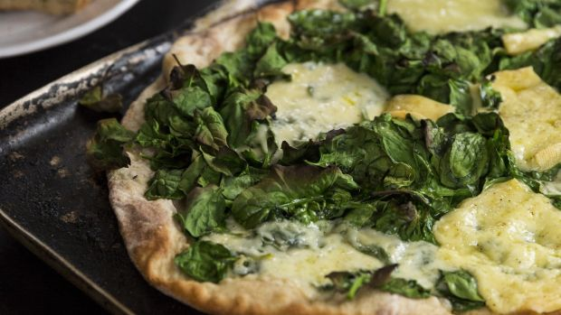 Spinach and Durrus cheese pizza. Photograph: Emma Jervis Photography