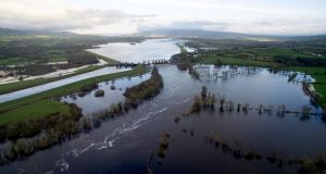 Flooding around Parteen Weir in Co Clare.  The Shannon-Dublin water pipeline will cost more than €1.2bn and its footprint will be immense.  Photograph: TISC