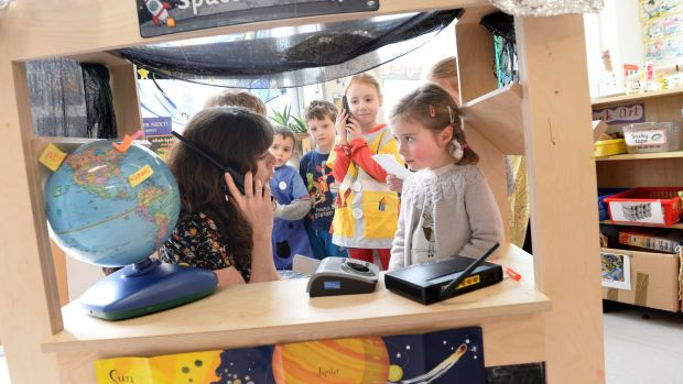 Sorcha Brennan, teacher at Glasnevin Educate Together, at play with junior infants. Photograph: Dara Mac Dónaill