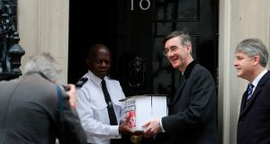 Conservative party member of parliament Jacob Rees-Mogg delivers a petition against the provision of foreign aid to 10 Downing Street in London on Thursday. Photograph: Daniel Leal-Olivas/AFP/Getty Images