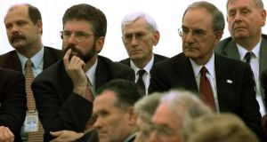 "Séamus Mallon, pictured in 1998 sitting behind Gerry Adams at an address in Belfast by Bill Clinton, has little affection for the Sinn Féin leader: ""I just can't be in the same room with him. There's just something about him that I recoil from. He has his hand in too many awful events, too many."" Photograph: AP"