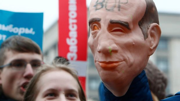 "A mask depicting Russian president Vladimir Putin with the word ""thief"" is seen during a rally in Moscow by supporters of opposition leader Alexei Navalny, calling for a boycott of the March 18th presidential election. Photograph: Sergei Karpukhin/Reuters"