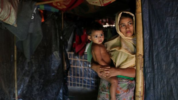 Rehana Khatun, whose husband Mohammed Nur was among 10 Rohingya men killed by Myanmar security forces and Buddhist villagers on September 2nd, with her child at Kutupalong camp in Cox's Bazar, Bangladesh. Photograph: Mohammad Ponir Hossain/Reuters
