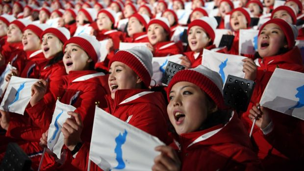 North Korean athletes sing and hold the unification flag depicting a unified Korean peninsula before the start of the opening ceremony of the Winter Olympics in Peongchang. Photograph: James Hill/The New York Times