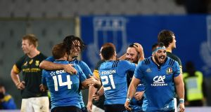 Italy's players celebrate victory over South Africa  in November 2016. Photograph: Filippo Monteforte/AFP/Getty