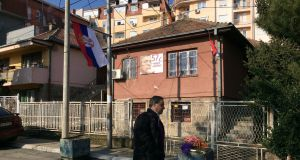 Flowers and candles mark the place in Mitrovica, Kosovo, where moderate Kosovo Serb politician Oliver Ivanovic was shot dead outside his office in January. Photograph: Dan McLaughlin