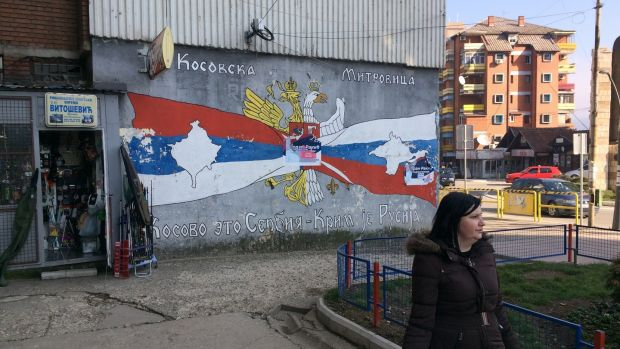 "Graffiti in the mostly Serb half of the city of Mitrovica in Kosovo, saying: ""Kosovo is Serbia, Crimea is Russia"". Photograph: Dan McLaughlin"
